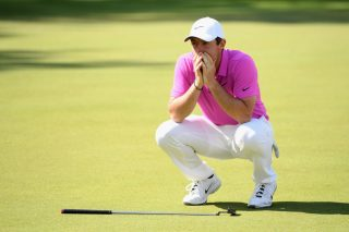 Close but no cigar: McIlroy missed eagle putt on the 18th green by an inch but ultimately came up two shots short after a lacklustre weekend's play